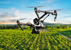 Image of Aerial Drone Photographing a field of crops